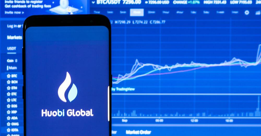 Huobi app in front of chart